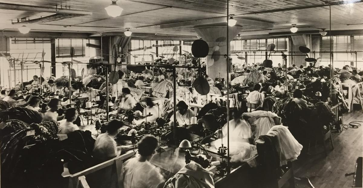 Photograph of the floor of the Nelly Don factory, showing well-lit working conditions