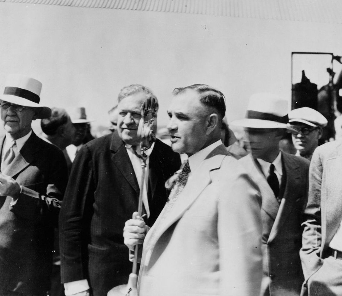 Lou Holland, Conrad Mann and other unidentified people at airport dedication.