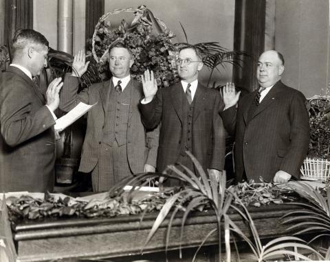 Harry Truman being sworn in as judge