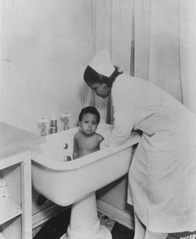 Bathing a child at Florence Home